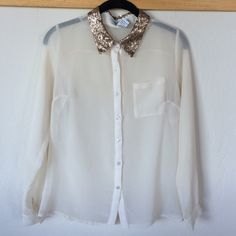 Long sleeve blouse with sparkling neck Color is beige Tops Button Down Shirts