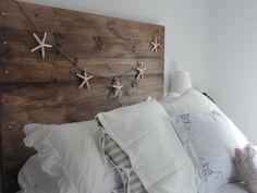 I love the look of starfish garland with the reclaimed headboard.  Very coastal chic!