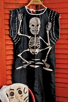 Beginning in the 1940s, manufacturers such as such as Ben Cooper Inc. began making costumes and selling them through Sears, JC Penney, Woolworths, and local five-and-tens for as little as $1.25. This skeleton outfit and hooded muslin mask is from the early 1950s.