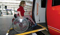 Woman in wheelchair using ramp to board train