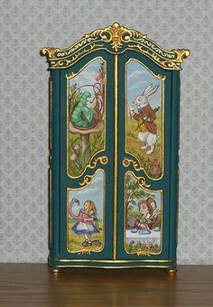 Leslie Lassige - Bespac wardrobe hand painted with Alice in Wonderland characters