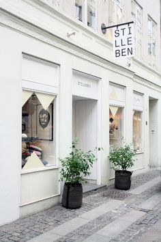 Stilleben Store Front with Blade Sign and Plants in Planters Design Café, Store Design, Interior And Exterior, Interior Design, Lokal, Shop Fronts, Retail Space, Retail Shop, Cafe Restaurant
