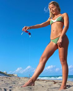 Giant Girl Playing With A Kitesurfer ..