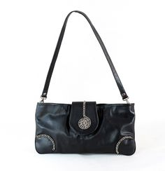Ladies' bag in genuine leather, elegant design. Provided with an adjustable strap, can be worn on the shoulder or as an envelope bag. Inside it is fitted with one compartment, zipper closed. Dimensions: 43*22*4 cm