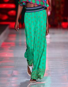 Absolutely love these trousers, if only they were in my price range! Flared green silk Toghu print pants