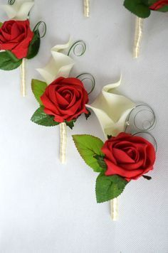 Calla Lilies and Rose wedding buttonholes, red, ivory, purple, cream, royal blue