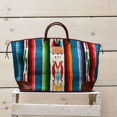 Bag made of vintage blanket http://www.directionalmotivationshop.com/product/teal-mexican-blanket-overnight
