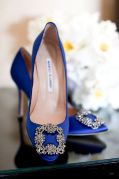 Man, I would love to get these for my Sarah as her something BLUE. Who doesn't love Manolo?