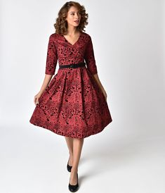The Sherwood Dress from Hell Bunny is a inspired swing dress with a story to tell! Elbow length sleeves compliment a plunging wrap style neckline to bring you vintage perfection. This lightweight cotton piece features black velvet silhouettes of a w Red Velvet Dress, Black Velvet, Vestidos Vintage, Vintage Dresses, 1950s Dresses, Plunge Dress, Vintage Velvet, Material Girls, Unique Dresses