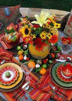 Mexican table that is set for dinner