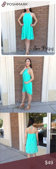Mint Beauty New Listing-4/23/17: This gorgeous dress features spaghetti straps and upper back tie detail.  Flowy sheer material and fully lined. Self-100% Polyester Lining-100% Polyester (This closet does not trade) Boutique Dresses Midi