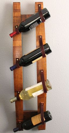 Hairpin console table idea leather straps Versatile repurposed oak wine stave hanging wine rack--- LOVE THIS IDEA. Built In Wine Rack, Wood Wine Racks, Leather Projects, Diy Wood Projects, Leather Crafts, Deco Cuir, Hanging Wine Rack, Barrel Projects, Wine Barrel Furniture