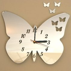 Butterflies out of Butterfly Clock Mirrors & 3 Baby Butterflies 25cm x 20cm by Cool Creations, http://www.amazon.co.uk/dp/B005Z1DI0I/ref=cm_sw_r_pi_dp_hHYhsb0J0TK6F