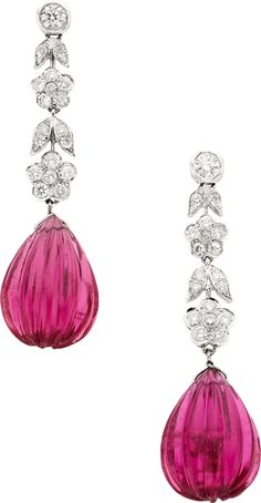 Tourmaline, Diamond, White Gold Earrings The earrings feature carved rubellite tourmaline briolette weighing a total of 16.62 carats, enhanced by full-cut diamonds weighing a total of approximately 0.70 carat, set in 18k white gold, completed by posts with friction backs. Gross weight 6.07 grams. Dimensions: 1-9/16 inch x 7/16 inch *Note: earrings are designed for pierced ears