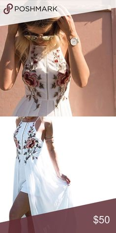 White dress Very beautiful white dress with rose detailing in the front. It's a romper underneath and white sheer rest of the dress is open and flows down. Real head turner Dresses Maxi