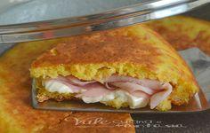 Torta salata senza forno con stracchino e prosciutto cotto , con cottura in padella buona sofficissima,è ottima come aperitivo e da portare al mare