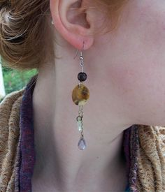 Recycled materials,  handmade. Lovely.  Etsy. http://www.etsy.com/listing/157653283/wood-shell-teardrop-dangle-earrings