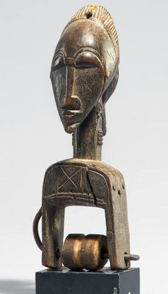 Africa | Heddle pulley from the Baule people of Ivory Coast | Wood and fiber
