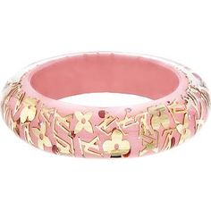 Pink bangle with gold embellishment.