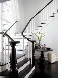 Love the glossy black stairs & banister against the crisp white. staircase, entry way, home design Black Banister, Painted Banister, White Staircase, Banisters, Staircase Design, Staircase Ideas, Stair Railing, Wood Stairs, Railings