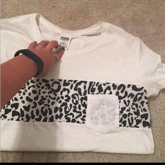 Vs pink shirt NWOT Been folded in my closet- fits about a medium- you don't see much of the cheetah prints anymore- 10$ on m PINK Victoria's Secret Tops Tees - Short Sleeve