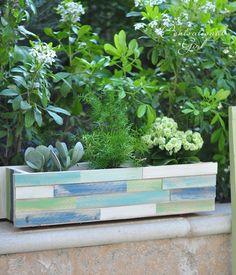Adapt pallet boards around a plastic planter...