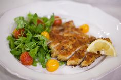 Quick Parm-crusted pork chops with an arugula and tomato salad