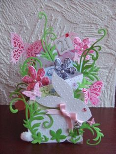 Waterfall / Cascade Card with butterflies and rabbit - 21st birthday - front view. Spellbinders Shapeabilities Floral Flourish