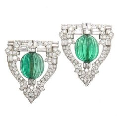 Circa 1930s Raymond Yard Emerald Diamond Platinum Dress Clips | From a unique collection of vintage brooches at https://www.1stdibs.com/jewelry/brooches/brooches/
