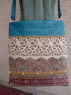 Teal Green Leather Messenger Bag With Lace And Tapestry Accents. $125.00, via Etsy.