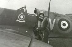 Canadian pilot James Henry Whalen posing with his Spitfire fighter, RAF Tangmere, West Sussex, England, United Kingdom, 1941-