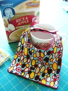 EASY template for a baby bib using a cereal box and coffee mug!