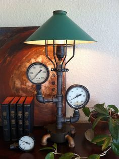 Staying true to the Industrial and Machine Ages we intertwined steam power and technology. This lamps sport components and functional widgets that Pipe Lighting, Industrial Lighting, Rustic Industrial, Cool Lighting, Lighting Ideas, Industrial Design, Tube Metal, Steampunk Lamp, Pipe Lamp
