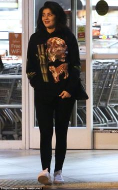 Playful: Kylie Jenner was seen wearing a tiger sweatshirt on a grocery run in Hollywood on Sunday, after reuniting with ex Tyga