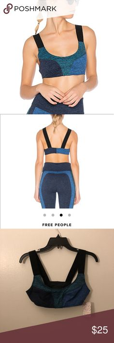 Free People Color Block Dylan Sports Bra Features Yoga sports bra. Super-soft and moisture-wicking double-brushed heather jersey fabric. Thick, over-the-shoulder straps for stay-put support. Scooped neckline. Color-blocked style.  Details Fabric(s): Main: 87% Polyester, 13% Spandex Lining: 94% Polyester, 6% Spandex Color: Blue Style Features: Color-blocked. Support: Medium Front Coverage: Medium Cups: No Adjustable: No  Runs Big Free People Tops