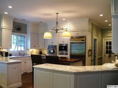 Not sure if those are soffits above the cabinets- but that would be a great and inexpensive way to update kitchen soffits by adding molding and painting them the same color as the cabinets- looks so much better