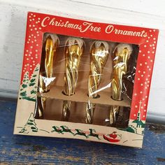 "$10 + ship | Vintage Japan ""Christmas Tree Ornaments"" complete box of four gold frosted mercury glass icicle ornaments. Box measures about 4.5 inches square. Cellophane is torn and box has some tape residue."