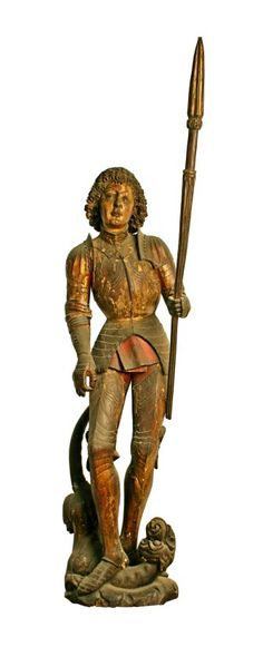 Bunratty Castle Medieval Collection: A Carved statue of St. George and the Dragon, original gilt decoration and polychrome paint. South German. 15th Century.
