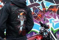Ed Hardy vest, uhm, ok.  Guess the scared bird is supposed to looks like angry bird.