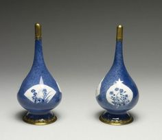 """Pair of Blue and White Bottles Mounted as Perfume Sprinklers.Porcelain: Kangxi period (1675-1725); Mounts: 18th century. Porcelain wth glaze """"souffle"""" powder blue and Persian (?) mounts.H: 7 1/4 in. (18.4 cm).Acquired by William T. or Henry Walters.49.1004, 49.1005.The Walters Art Museum"""
