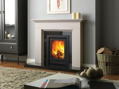 Offering a range of wood-burning and multi-fuel stoves along with beautiful limestone fireplaces, Fireline is one of the leading manufacturers in the UK. Painted Fireplace Mantels, Inset Fireplace, Wood Burner Fireplace, Fake Fireplace, Limestone Fireplace, Black Fireplace, Living Room With Fireplace, Fireplace Surrounds, Fireplace Design