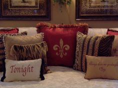 The red and leopard print pillows!!! Notice the picture matting is done in leopard print also-