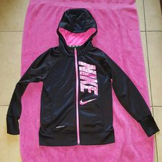 Nike jacket Black Nike girls jacket size L..in perfect condition no fading or peeling of nike letters..super cute has front pockets for extra warmth..the back of jacket is all black Nike Jackets & Coats
