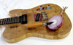 #DIY turn an Ikea cutting board into a completely playable electric guitar! The wood grain detailing is so striking #creative #inspired