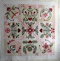 """I love the quilting on this one. It adds so much texture to the applique. I think the border is """"faux-nine-patched"""" to echo the 9-patches through out the quilt. Stunning! Now I have to go read the blog from whence it came..."""