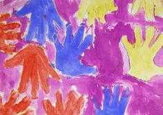 "Students traced the outline of their hand with oil pastel. They then reviewed the three primary colors and used those colors to paint the shapes inside their hand. They chose their ""favorite"" secondary color to paint the background. this project helps the students to practice their fine motor skills, and experiment more with paint."