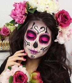 Colorful Sugar Skull Halloween Look ★ A Halloween look without sugar skull makeup is a look wasted! Our tunning ideas with glitter, rhinestones, and the burst of glam colors are here to help you keep up with the fancy Mexican tradition stylishly. Maquillage Sugar Skull, Yeux Halloween, Halloween Nails, Candy Skulls, Sugar Skulls, Sugar Skull Face Paint, Candy Skull Makeup, Halloween Makeup Sugar Skull, Halloween Makeup Looks