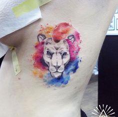 Watercolor lion tattoo by Cynthia Sobraty