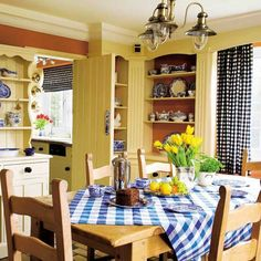Country kitchen...love the yellow walls and  gingham fabrics