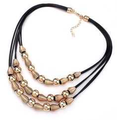 c9b5647a32cb Brass beads adorn this leather cord